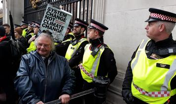 Extinction Rebellion activist glued to Buckingham Palace gate