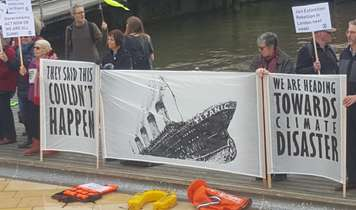 Titanic flash mob call for immediate action on  climate change