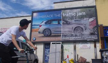 Guerilla take over of 100 UK billboards in anti-car protest